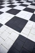 Checkerboard, black and white checked path Stock Photos