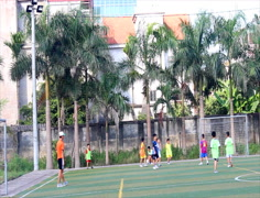 Boys playing football on the court, Asia Stock Footage
