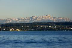 View from lake constance near konstanz towards the alpstein range with santis Stock Photos