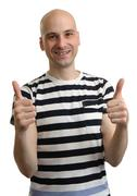 Handsome casual man holds his thumbs up Stock Photos