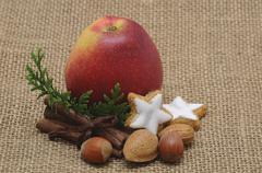 apple, cinnamon, nuts, christmas motif - stock photo