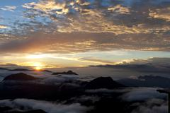 Cloudy sky, sunrise over the mountains, view from adam's peak, sri pada, zent Stock Photos