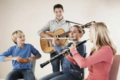 Teenagers making music together Stock Photos