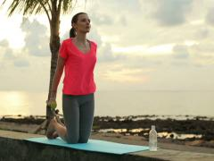 Vyoung, pretty woman  exercising with dumbbel on the wall by the sea NTSC Stock Footage