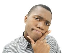 young man, african-american, american, pensive face, sceptical - stock photo
