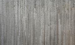 Faded, weathered wooden wall of planed boards Stock Photos