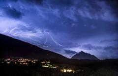 Ominous clouds and lightning bolts from thunderclouds over the stubai valley  Kuvituskuvat