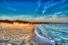 hdr coastline at dusk - stock photo
