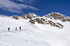 mountain climbers ascending staudenberg joechl mountain in ridnaun above schn - stock photo