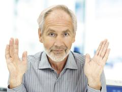 senior, expression of helplessness - stock photo