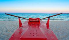lifeboat on the sand - stock photo