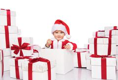 Stock Photo of baby boy in santa claus costume sitting inside gift box