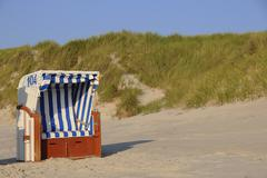 roofed wicker beach chair, dunes, north sea, amrum, schleswig-holstein, germa - stock photo