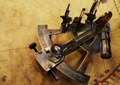 Sextant on an old map Stock Photos