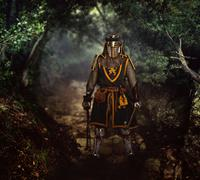 Medieval knight on an old damaged road. Stock Photos