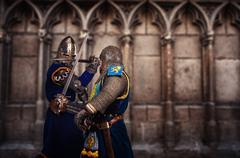Two knights fighting agaist medieval cathedral wall. Kuvituskuvat