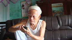 Old man using mobile phone, Asia Stock Footage
