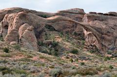 landscape arch, rock arch made of red sandstone, devils garden, arches nation - stock photo