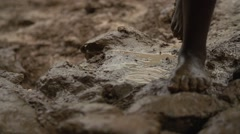 African Child from Batwa Tribe Walking in Mud, Uganda Stock Footage