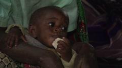 African Baby from Batwa Tribe Eating, Uganda - stock footage