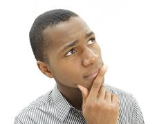 african-american man, young american, pensive face, sceptical - stock photo