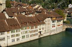 row of houses along the riverbank of the aare river in the historic town cent - stock photo