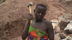 African Woman Hammering Rocks in a Quarry in Uganda, Africa Stock Footage