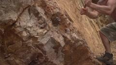 Man Hammering Rocks in a Quarry in Slow Motion, Uganda, Africa Stock Footage
