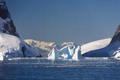 archway iceberg, lemaire channel, antarctic peninsula, antarctica - stock photo