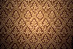 old retro wallpaper in sepia - stock photo