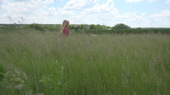 Little Girl Playing in Tall Grass, Child Relaxing Outdoor in Field, Countryside Stock Footage