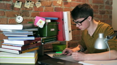 Student counting task on his calculator and receiving positive result Stock Footage