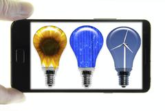 Mobile phone with a photo of light bulbs, symbolic image for renewable energy Stock Illustration