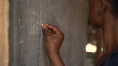 African Teacher Writing on the Blackboard in Kabale, Uganda Stock Footage