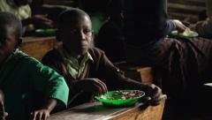 African Children Eating in Slow Motion, Uganda - stock footage