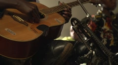 African Disabled Man Playing the Guitar in Kabale, Uganda Stock Footage