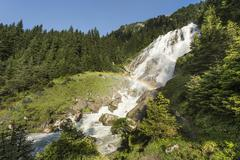 Grawa waterfall at the wild water way, with rainbow, grawa alm, mountain past Kuvituskuvat