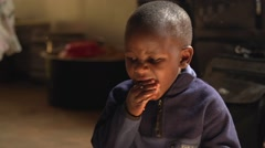 African Child Eating in Slow Motion, Uganda - stock footage
