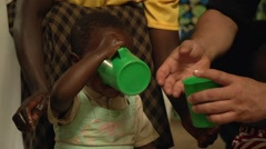 African Baby Drinking Water in Slow Motion, Uganda Stock Footage