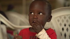 African Baby Eating in Slow Motion, Uganda Stock Footage