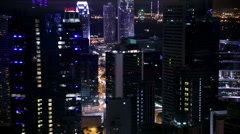 Cityscape descending night view of high rise buildings. Stock Footage