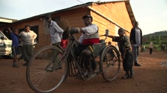 African Disabled Man Riding a Bike in Kabale, Uganda Stock Footage
