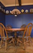 Antique table and chairs in the kitchen of a 1998 reproduction of an old cana Stock Photos