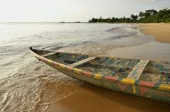 Fishing boat, pirogue, on the beach in kribi, cameroon, central africa, afric Stock Photos
