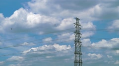 Time lapse of A High voltage towers with blue sky and clouds - stock footage