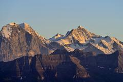 Eiger north face with eiger, monch and jungfrau mountains in the morning ligh Stock Photos