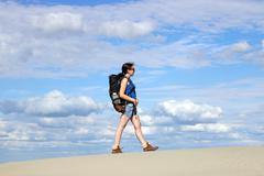 girl hiker walking in the desert - stock photo