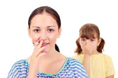 smoking can cause asthma and diseases in children - stock photo