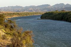 The Orange River also Oranje or Gariep River at Sendelingsdrif border river Stock Photos