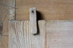 Wooden latch on rustic style cupboard, stuttgart, baden-wuerttemberg, germany Stock Photos